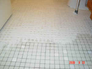 bathroom floor during grout coloring